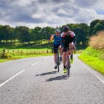 two-cyclists-country-road
